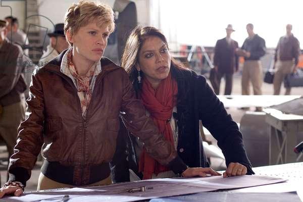 Amelia: AMELIA, from left: Hilary Swank as Amelia Earhart, director Mira Nair, on set, 2009. ph: Ken Woroner/©Fox Searchlight/courtesy Everett Collection