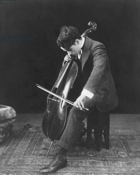 Charlie Chaplin playing the cello, ca. 1920