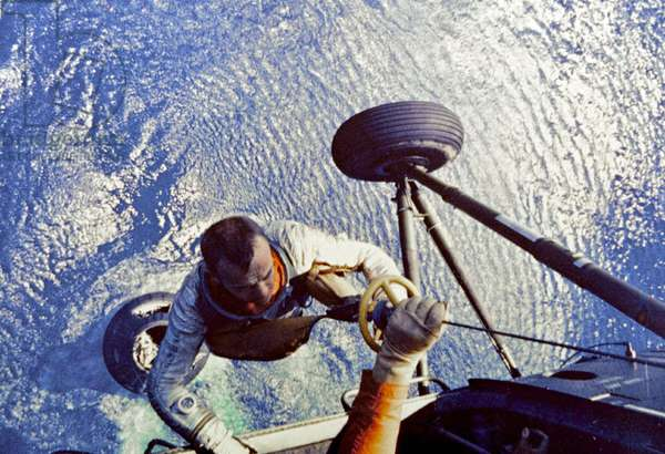 Mercury 3 : Alan Shepard: Astronaut Alan B. Shepard is hoisted aboard a U.S. Marine helicopter after splashdown of his Freedom 7 Mercury space capsule. Shepard was the first American, and second human after Russian Yuri Gargarin, to make a manned space flight. May 5, 1961.