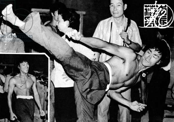 "BRUCE LEE flexes up during a promotion for his new martial arts school ""Bruce Lee Jeet-Kune-do Club"", Hong Kong, 1980"