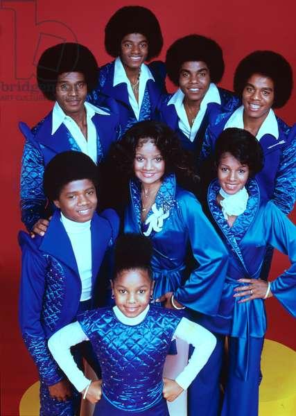 JACKSONS, THE, [front] Janet Jackson; [center, l-r] Randy Jackson, LaToya Jackson, Rebbie Jackson; [back, l-r], Jackie Jackson, Michael Jackson, Tito Jackson, Marlon Jackson, 1976-1977
