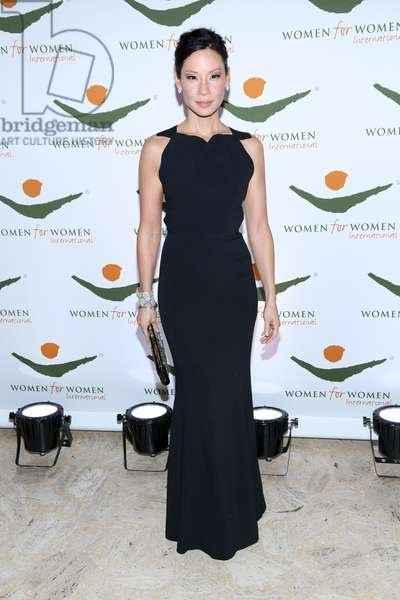 Lucy Liu (wearing a Roland Mouret gown) at arrivals for Women for Women International (WfWI) 2012 Gala, David H. Koch Theatre at Lincoln Center, New York, NY November 8, 2012. Photo By: Andres Otero/Everett Collection