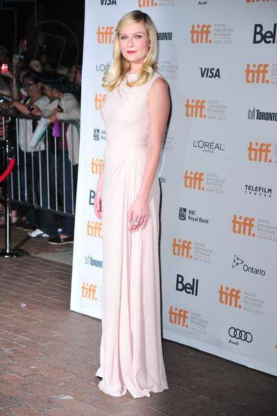 Kirsten Dunst (wearing a Christian Dior gown) at arrivals for ON THE ROAD Premiere at Toronto International Film Festival, Ryerson Theatre, Toronto, ON September 6, 2012. Photo By: Gregorio Binuya/Everett Collection