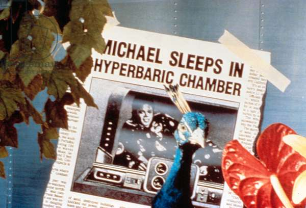 MICHAEL JACKSON, making fun of the tabloid coverage of his sleeping in a hyperbaric chamber, in MOON