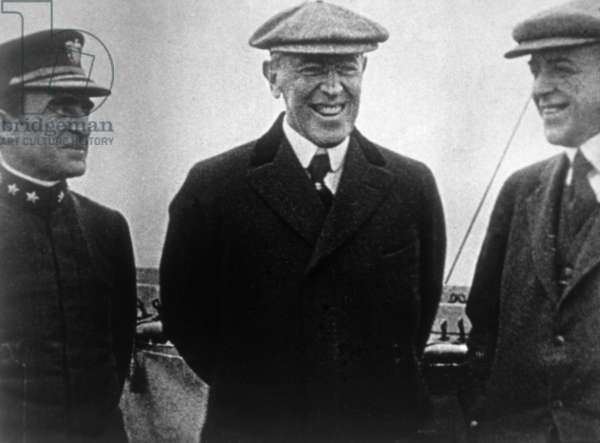 President Woodrow Wilson (center) en route to Paris for post-war peace conference, 1919