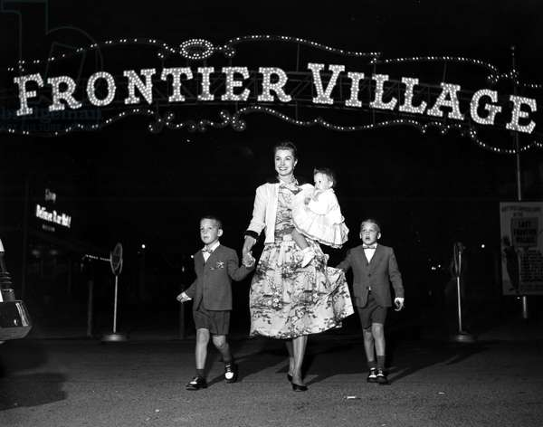ESTHER WILLIAMS and her children at the Frontier Village, Las Vegas, Nevada. 1954