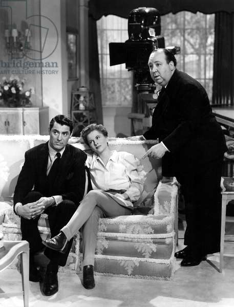 SUSPICION, Cary Grant, Joan Fontaine, and Alfred Hitchcock on the set, 1941