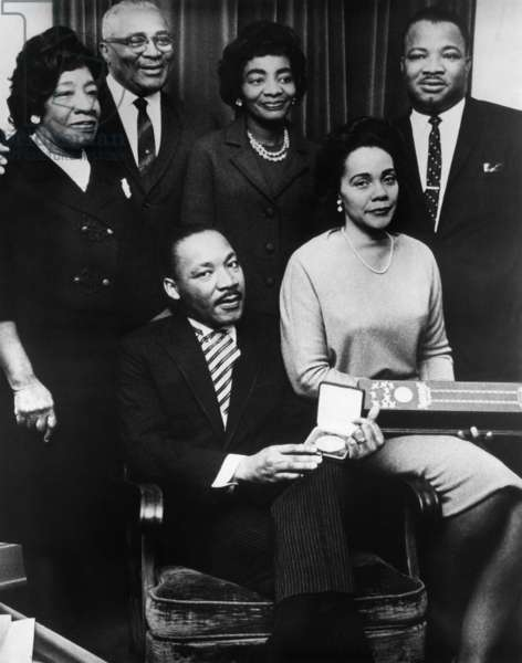Martin Luther King, Jr., (seated), with his parents, Martin Luther King, Sr., and Alberta Williams King, his sister, Christine King Farris, his brother, A.D. King, and his wife, Coretta Scott King, (seated), accepting the Nobel Peace Prize, 1964
