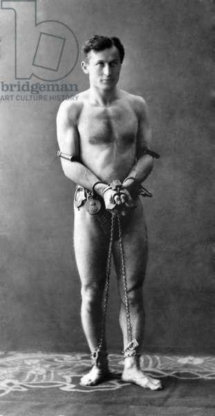 Harry Houdini: Harry Houdini (1874-1926), in chains. Ca. 1900.