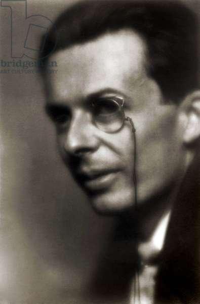 Aldous Huxley: Aldous Huxley (1894-1963), English author of the science fiction dystopian classic, BRAVE NEW WORLD (1932). 1926 portrait with monocle by Pirie McDonald.