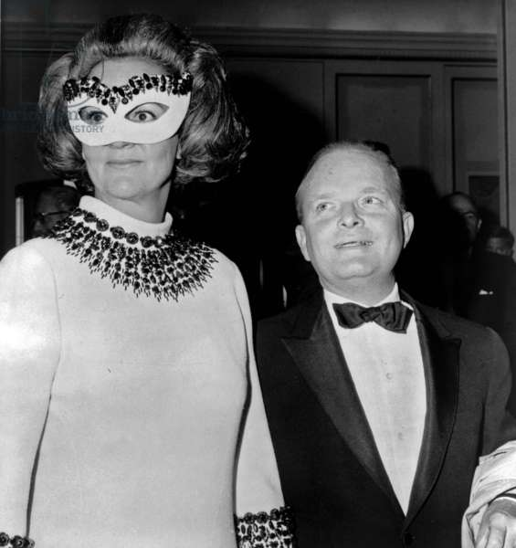 """Truman Capote: Truman Capote (1924-1984), southern American writer with Washington Post publisher, Katherine Graham (1917-2001), at his 1966 """"Black and White"""" ball."""