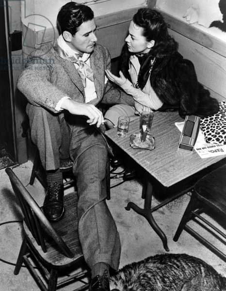 ERROL FLYNN and OLIVIA DE HAVILLAND between takes, 1930s