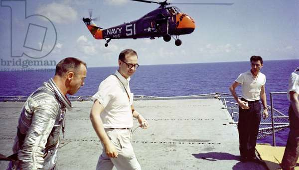Mercury 3 : Alan Shepard: Astronaut Alan B. Shepard on the deck of the aircraft carrier, U.S.S. Lake Champlain, after the recovery of his Freedom 7 Mercury space capsule. May 5, 1961.