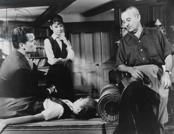 THE CHILDREN'S HOUR, from left, James Garner, Audrey Hepburn, Karen Balkin, (on bed), director: THE CHILDREN'S HOUR, from left, James Garner, Audrey Hepburn, Karen Balkin, (on bed), director William Wyler, 1961