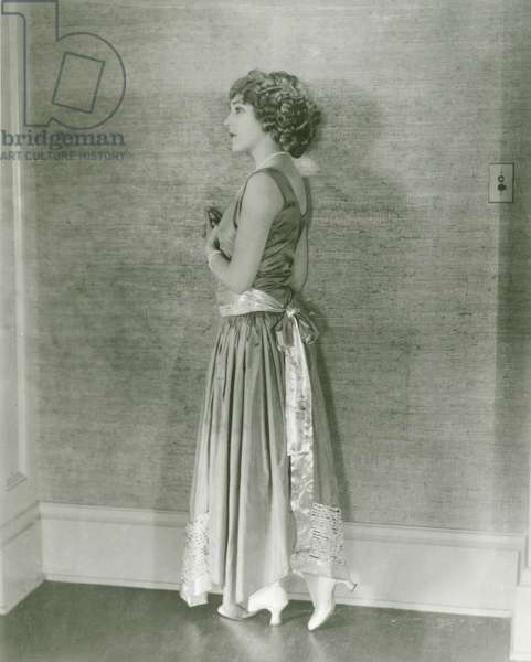Mary Pickford, wearing a dress that she calls her 'Water Lily' dress, designed by Jeanne Lanvin, early 1920s.