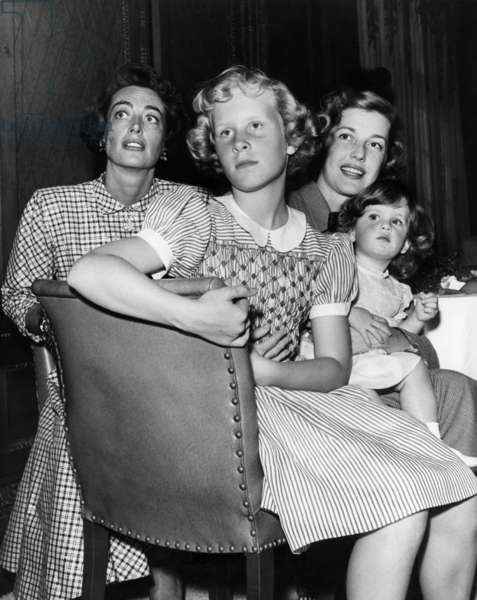 Joan Crawford and Anita Louise with their daughters, Christina Crawford and Melanie Adler, 1949