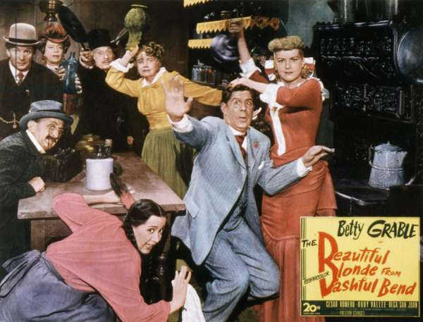 THE BEAUTIFUL BLONDE FROM BASHFUL BEND, El Brendel, (far left), Olga San Juan, (crouching), Rudy Vallee, Betty Grable, 1949, TM and copyright ©20th Century Fox Film Corp. All rights reserved / Courtesy: Everett Collection