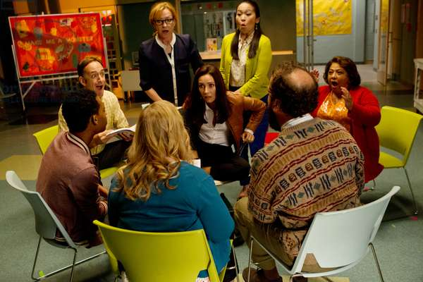 GO ON, (standing in back, from left): Julie White, Suzy Nakamura, (middle): Seth Morris, Laura Benanti, Tonita Castro, (front, with backs to camera): Tyler James Williams, Sarah Baker, Brett Gelman, 'Do You Believe in Ghosts? Yes!', (Season 1, ep. 105, airing Oct. 5, 2012), 2012-. photo: Justin Lubin / © NBC / Courtesy: Everett Collection