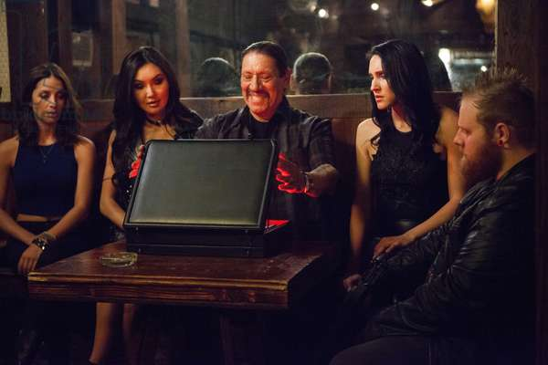 CROSS WARS, Soo Yeon Lee (left of center), Danny Trejo (center), Sabrina Campbell (right of center), 2017. © Sony Pictures Entertainment /Courtesy Everett Collection