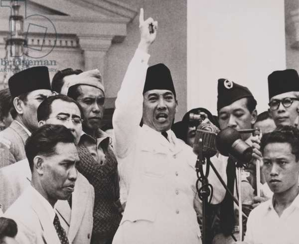Indonesian President Sukarno, trying to calm thousands of angry demonstrators. Sept. 1950. The crowd demanded the dissolution of Parliament and general elections. Sukarno promised elections as soon as possible, which turned out to be Sept. 29, 1955. - (BS: Indonesian President Sukarno, trying to calm thousands of angry demonstrators. Sept. 1950. The crowd demanded the dissolution of Parliament and general elections. Sukarno promised elections as soon as possible, which turned out to be Sept. 29, 1955. - (BSLOC_2014_15_181)