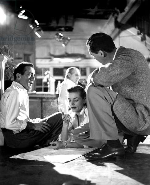 John Huston with Humphrey Bogart, Lauren Bacall and Lionel Barrymore (background) on the set of KEY LARGO, 1948