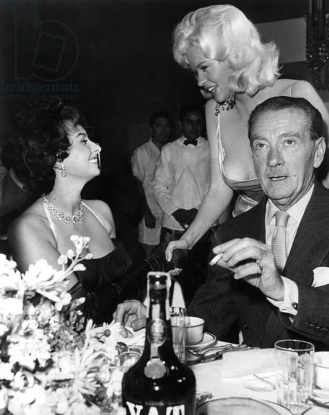 Sophia Loren And Jayne Mansfield Shake Hands While Clifton Webb Sits Awkwardly By, Ca. 1957