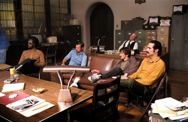 AMERICAN GANGSTER, Rza (sunglasses), John Hawkes (black sneakers), Yul Vazquez (seated right), 2007, © Universal/courtesy Everett Collection