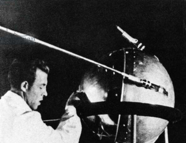 Russian technician with Sputnik 1. The Russian satellite was the first human-made object into space. It was a pressurized sphere made of aluminum alloy launched on Oct. 4, 1957.