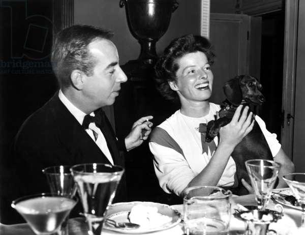 Vincente Minnelli and Katharine Hepburn with George Cukor's pet, Amanda, ca. 1940s