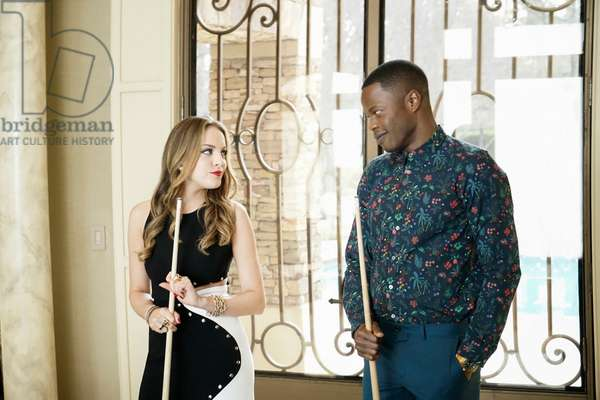 DYNASTY, l-r: Elizabeth Gillies, Sam Adegoke in 'I Hardly Recognized You' (Season 1, Episode 1, aired October 11, 2017). ph: Jace Downs/©The CW Network/courtesy Everett Collection