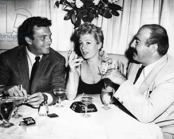 Newlyweds Anthony Franciosa, Shelley Winters with playwright Michael Gazzo at the Harwyn Club, 1957