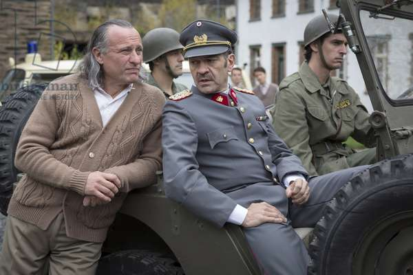 THE COLONY, (aka COLONIA), foreground from left: Michael Nyqvist, Marcelo Vilaro as General Augusto Pinochet, 2015. © Screen Media Films / courtesy Everett Collection
