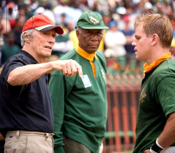 INVICTUS, from left: director Clint Eastwood, Morgan Freeman as Nelson Mandela, Matt Damon, on set, 2009. ©Warner Bros./courtesy Everett Collection