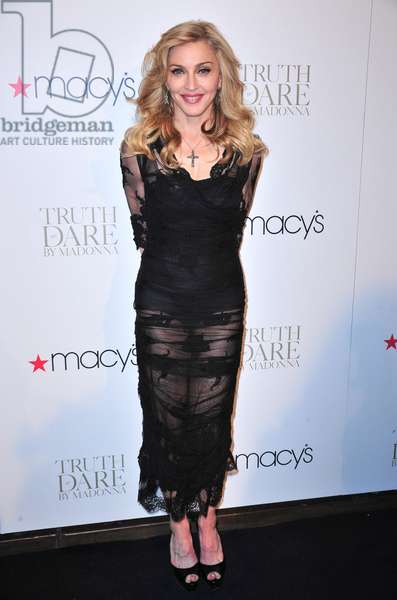Madonna: Madonna (wearing a Dolce & Gabbana dress) in attendance for Truth or Dare by Madonna Eau de Parfum Launch, Macy's Herald Square Department Store, New York, NY April 12, 2012. Photo By: Gregorio T. Binuya/Everett Collection