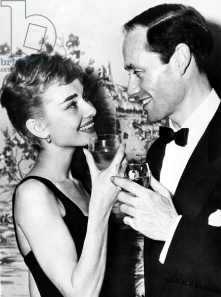 Newlyweds Audrey Hepburn and Mel Ferrer toast each other during honeymoon in Italy, 09-25-1954.