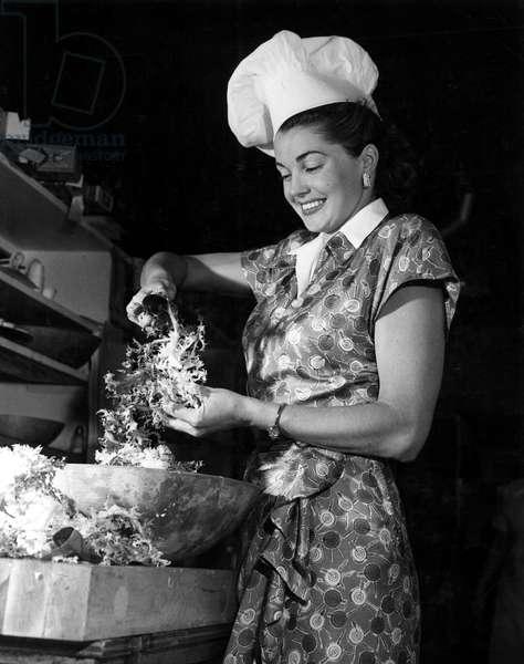 ESTHER WILLIAMS preparing a salad at the Del Mar Hotel, 1947.
