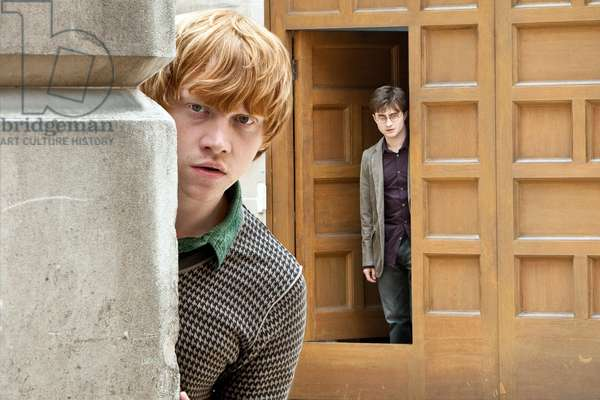 Harry Potter 7: HARRY POTTER AND THE DEATHLY HALLOWS: PART 1, from left: Rupert Grint, Daniel Radcliffe, 2010. ph: Jaap Buitendijk/©2010 Warner Bros. Ent. Harry Potter publishing rights ©J.K.R. Harry Potter characters, names and related indicia are trademarks of and ©Warner Bros. Ent. All rights reserved./Courtesy Everett Collection