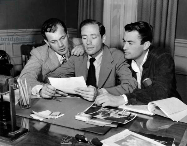 Mel Ferrer (center) confers with Joseph Cotten (left) and Gregory Peck (right) regarding their summer stock project, ca. 1947