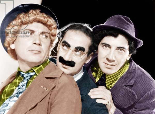 From left: Harpo Marx, Groucho Marx, Chico Marx, (the Marx Brothers), MGM portrait, ca. 1940