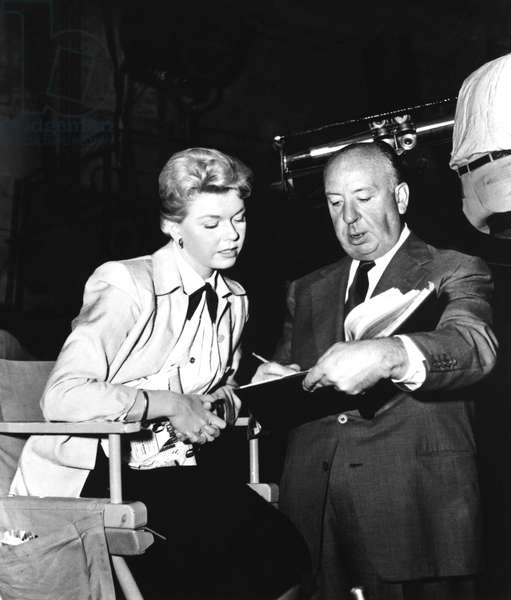 THE MAN WHO KNEW TOO MUCH, from left: Doris Day, Alfred Hitchcock on set, 1956