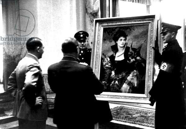 THE RAPE OF EUROPA, Adolf Hitler (left), presenting a painting (The Falconer, 1880, by Hans Makart, which Hitler had bought legitimately) to Hermann Goering (second from left), 2006. ©Actual Films/courtesy Everett Collection