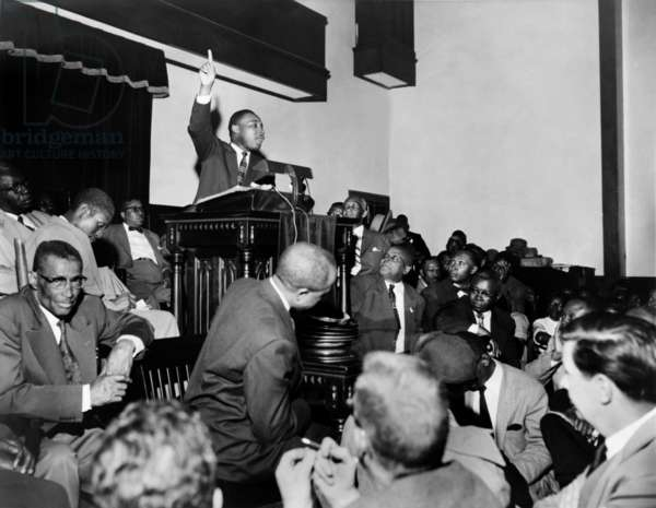 Martin Luther King: Rev. Martin Luther King, Jr., speaking at a meeting of the Montgomery Improvement Association, the organization form after Rosa Parks was arrested for not moving to the back of the bus. Earlier, King, then, only 27 years old, was elected the organization's leader. 1956.