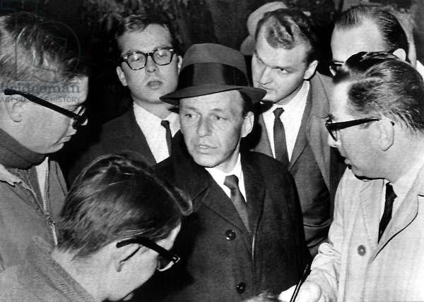 FRANK SINATRA answers reporter's questions regarding the kidnapping of his son, 1963