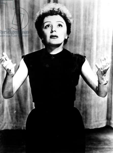 EDITH PIAF, (1915-1963) singing, circa 1940s-1950s.