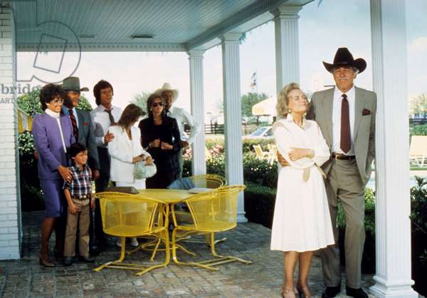 DALLAS, (from left): Linda Gray, Omri Katz, Larry Hagman, Patrick Duffy, Priscilla Presley, Susan Howard, Steve Kanaly, Donna Reed, Howard Keel, (Season 8), 1978-91.