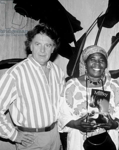 Chris Blackwell (of Island Records) and Rita Marley, circa 1990s (b/w photo)
