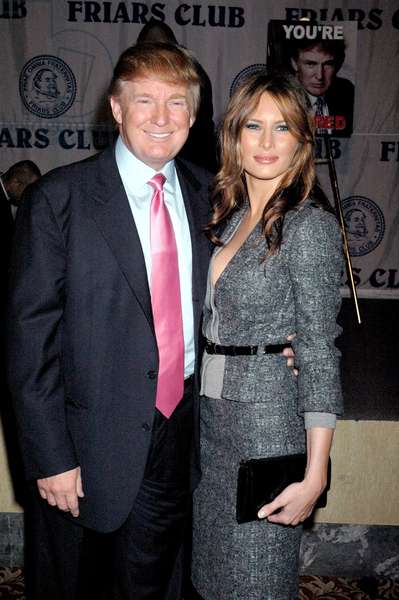 Donald Trump and Melania Knauss at the FRIAR'S CLUB ROAST FOR DONALD TRUMP, NY, October 15, 2004. (photo by Rob Rich/The Everett Collection)