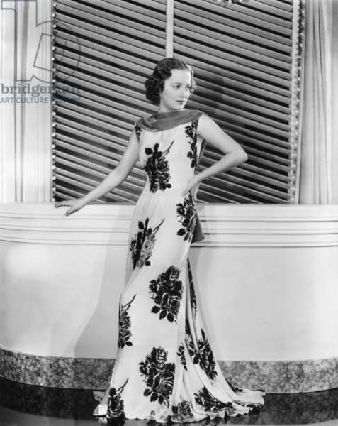 CALL IT A DAY, Olivia De Havilland, in an evening gown of printed crepe, 1937: CALL IT A DAY, Olivia De Havilland, in an evening gown of printed crepe, 1937