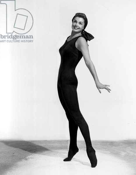 ESTHER WILLIAMS stretching in a skin-tight leotard. 1952.
