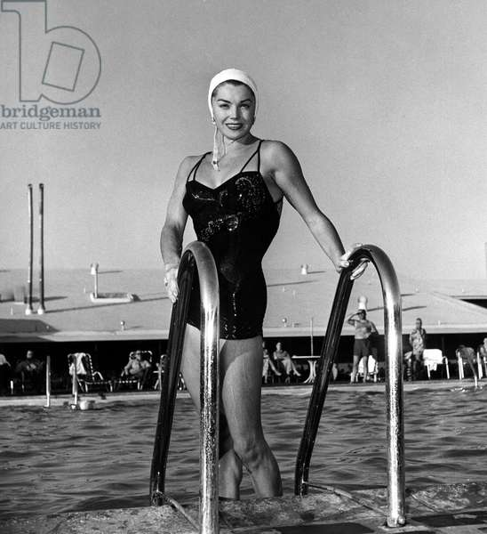 ESTHER WILLIAMS coming out of a swimming pool. 1954.